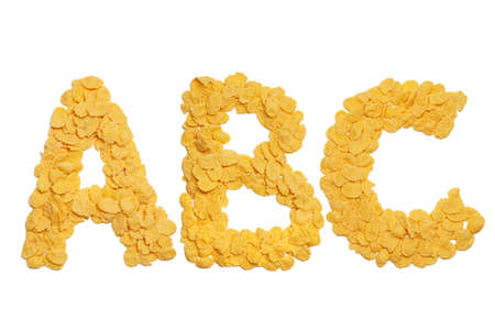 cornflakes: abc letters made of cornflakes over white background Stock Photo