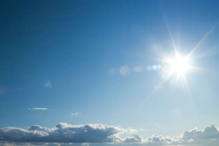 blue sky with the sun causing lens flare Stock Photo