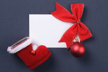 greeting card and christmas red decoration over grey background photo