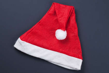 santas cap over grey background Stock Photo - 11554042