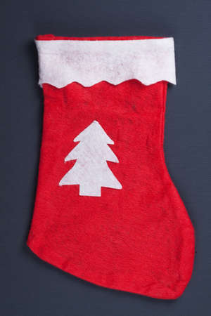 red stocking over grey background christmas concept Stock Photo - 11782855