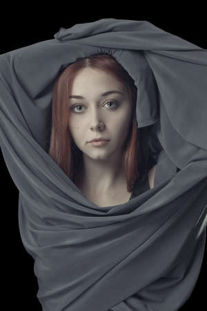 portrait of young girl with grey cloth Stock Photo - 12704920