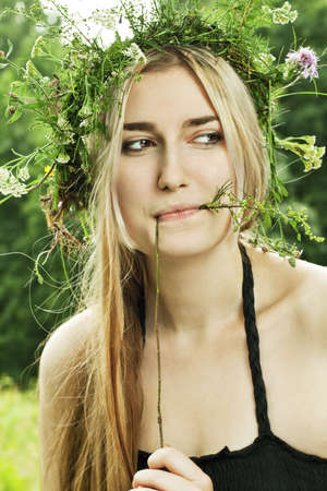beautiful girl in summer forest photo