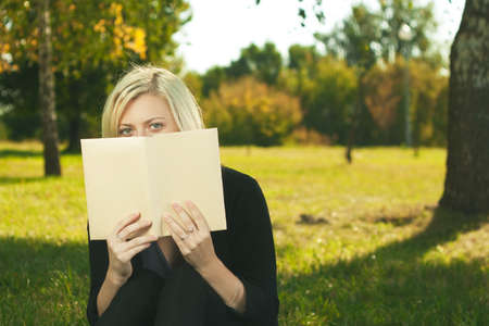 student girl reading in park Stock Photo - 14695335
