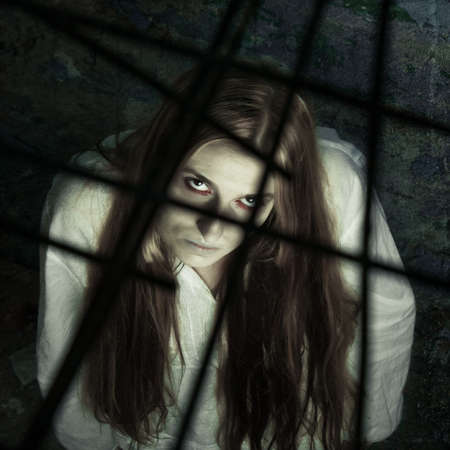 zombie girl behind lattice photo