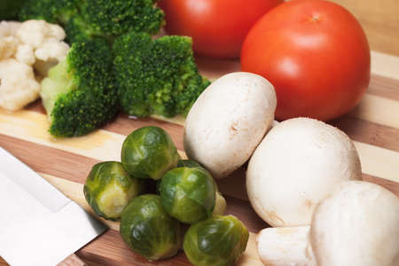 fresh food ingredients and knife on the breadboard photo