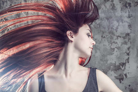 flying hair: girl with flying hair over grunge background Stock Photo