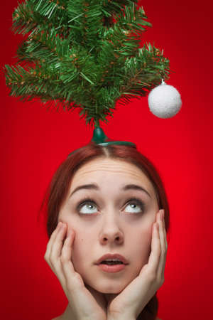 surprised girl over red background  christmas is at hand Stock Photo - 15513242