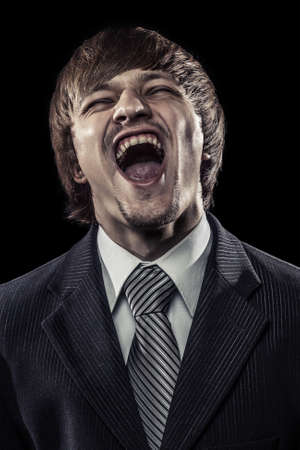 sarcastic: young successful businessman laughing hard over black