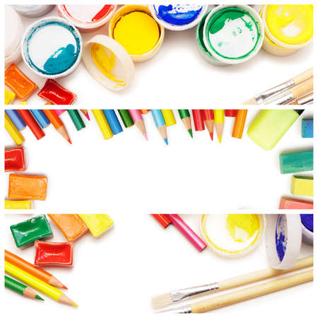 composition of multicolored drawing instruments over white background photo