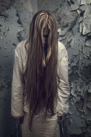 zombie girl with loong hair in an abandoned building Stock Photo
