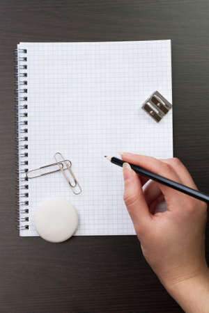 woman writing with pencil on notebook in office Stock Photo - 15612521