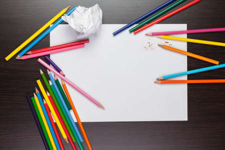 drawing table: blank sheet of paper with colorful pencils creative process Stock Photo