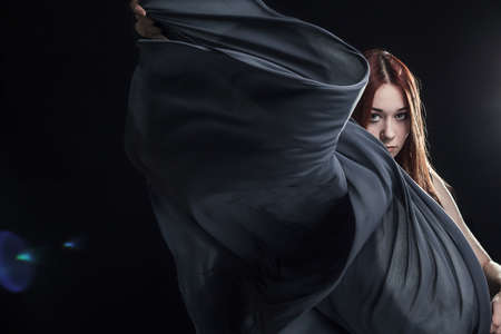 portrait of young girl dancing with long grey cloth Stock Photo - 15833441