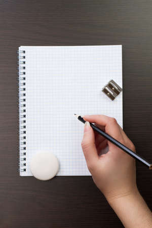 woman writing with pencil on notebook in the office Stock Photo - 15809148