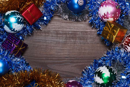 gifts and christmas decoration over wooden background photo