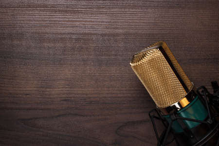 condensing: vintage condensing microphone on the wooden background