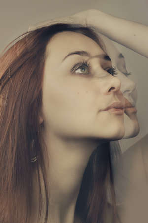 double exposure portrait with different facial expression Stock Photo - 16711040