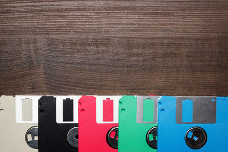 retro technology concept diskette on wooden background Stock Photo