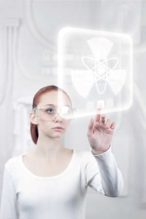 female scientist working in the futuristic laboratory photo