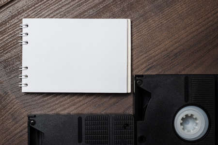 vhs videotape: old retro video tape over wooden background