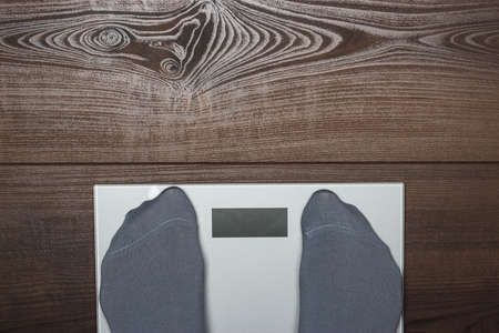 electronic scales on the wooden floor Stock Photo - 17541176