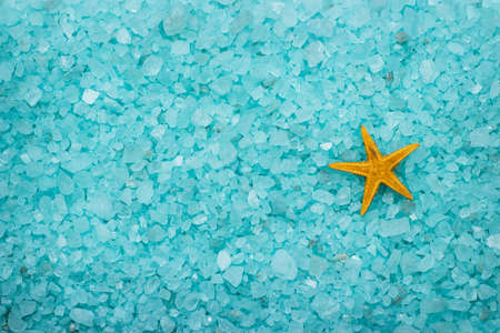 cushion sea star: blue aromatic bath salt and starfish background Stock Photo