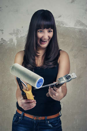 shoked: shoked young girl holding tools over grunge background