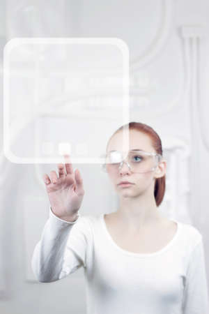 woman working with futuristic interface Stock Photo - 18434907