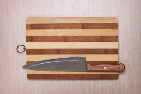 big knife and breadboard on table Stock Photo - 18448271