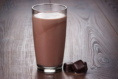 eating chocolate: glass of chocolate milkshake on the table