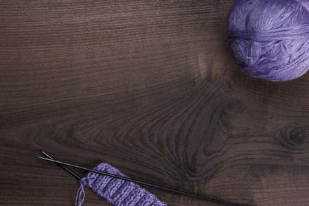 knitting needles: knitting needles and balls of threads on wooden background