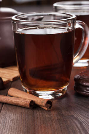 cup of tea with cinnamon sticks photo