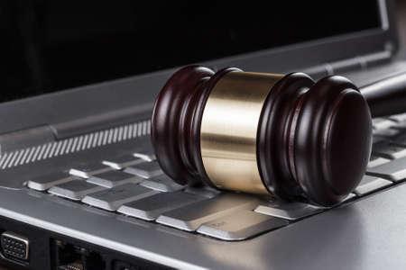 judge gavel on computer concept photo