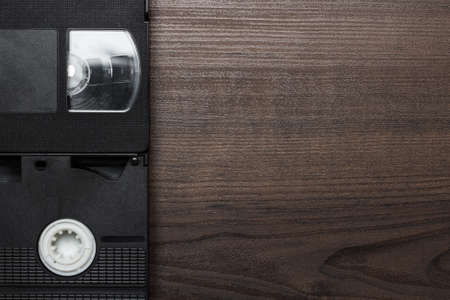 video cassette tape: old retro video tapes over wooden background Stock Photo