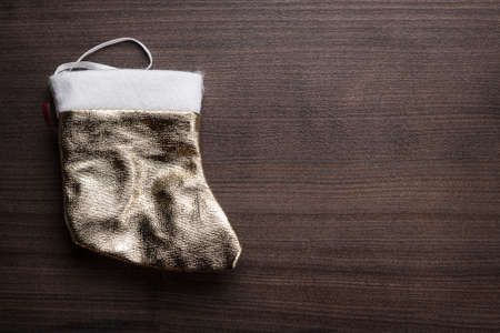 christmas sock on the brown wooden background photo