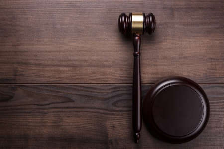 judge gavel on the brown wooden background photo