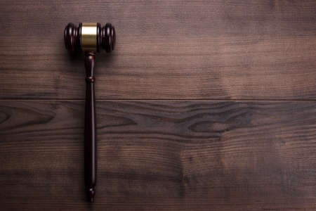 law: judge gavel on the brown wooden table with space for text