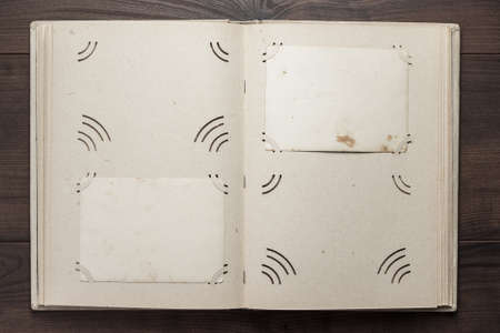 photo album: vintage opened album for photos on the wooden table Stock Photo