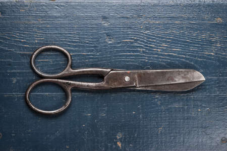 clippers: old black scissors on the wooden background Stock Photo