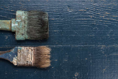 repaint: old brushes on the blue wooden table