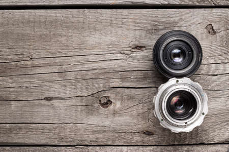 retro camera lenses on the wooden table photo