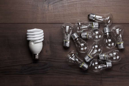 uniqueness: bulb uniqueness concept on brown wooden table