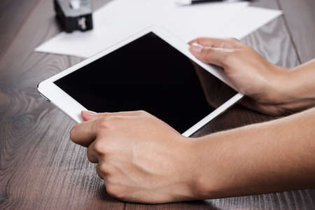 women hands with tablet computer on the table Stock Photo - 22965770
