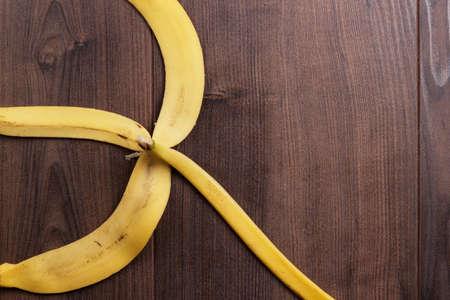 banana skin: banana peel on the brown wooden