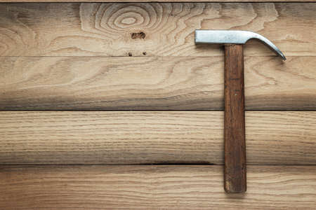 claw hammer on the brown wooden background photo