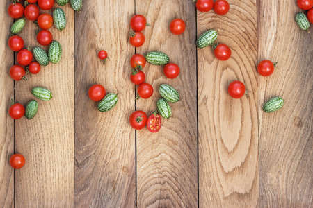 cherry tomatoes and kiwano on the table photo