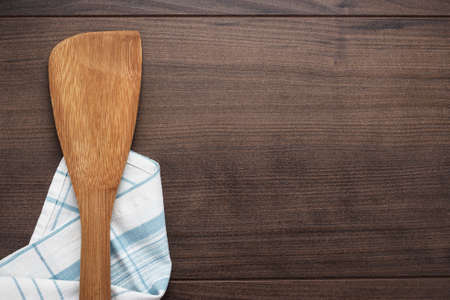 wooden spatula on the brown table background photo