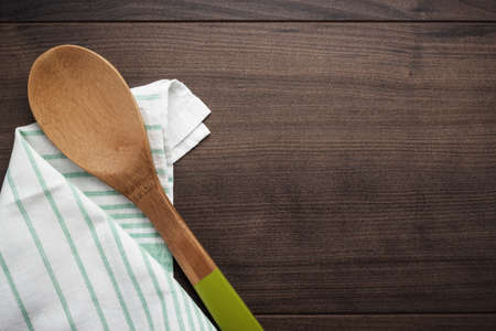 wooden spoon on the brown table background photo