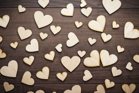 romantics: wooden heart shapes on the brown table